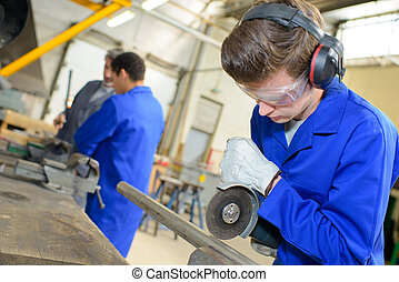 young man cutting steel