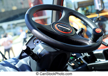 Work place in forklift with dashboard and wheel