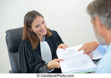Lawyer looking at paperwork with man