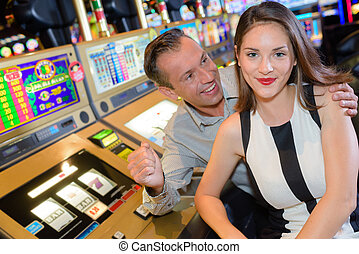 Triumphant couple in casino