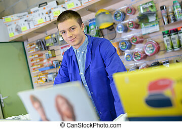 Young male shopkeeper