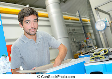 Factory worker packing carton