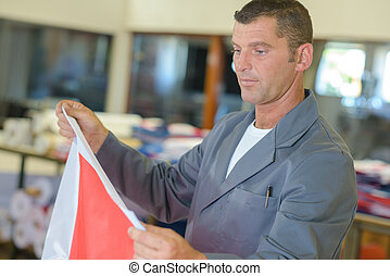 Man holding square of material