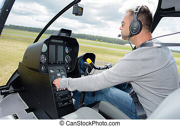 pilot operating a helicopter