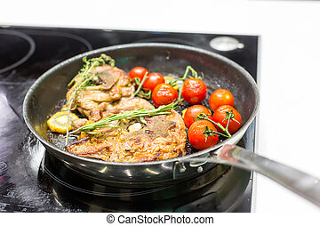 Meat with vegetables on the frying pan