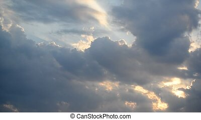 Clouds at sunset, camera movement - A Clouds at sunset,...