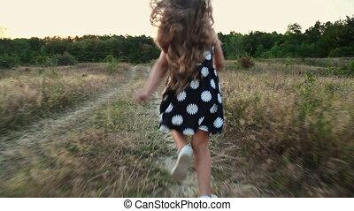 little girl running in nature