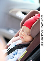 Baby sleeping in car seat - Six months old baby sleeping in...