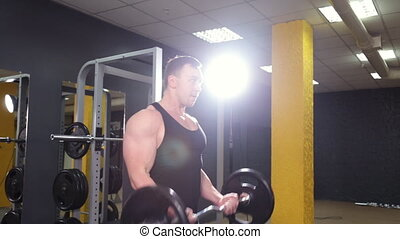 Man doing weight lifting in gym