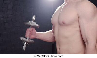 Strong bodybuilder with six pack, perfect abs, shoulders,...