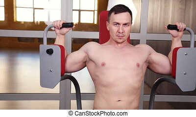 Butterfly Exercise Machine - Young Bodybuilder Doing Heavy...