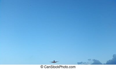 Airliner lands, view from below