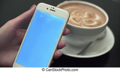 Woman Using a Mobile Phone with Blue Screen - Girl in the...