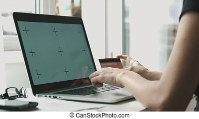 Woman with credit card - Girl with credit card and laptop