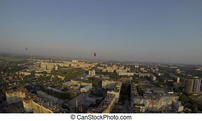 Air balloons flying over town. Summer landscape - Hot air...