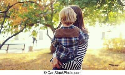 Mother and her child enjoy the early autumn in slowmotion....