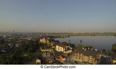 Breathtaking aerial view of town near lake at summer time