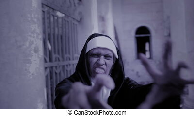 zombie nun. devilish woman in nun costume walking around the...