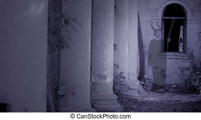 horned witch ghost walks through the ruins of the castle. halloween Horror