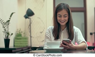 Woman Using App on Smartphone in Cafe Slow Motion - Woman...