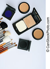 makeup brush and cosmetics, on a white background