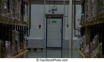 Warehouse. View of racks with pallets and boxes -...