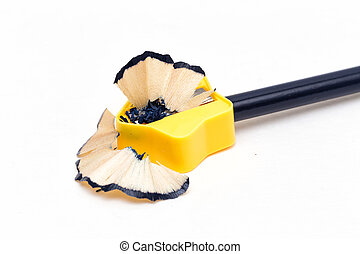 Sharpening - A pencil sharpener sharpening a pencil