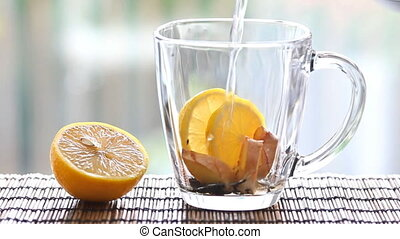 Tea with ginger and lemon. - Cup of hot tea with ginger and...