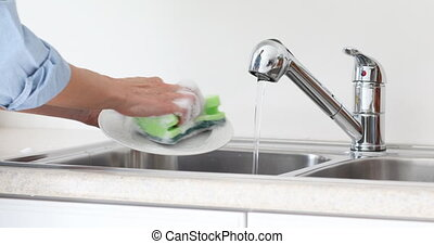 Woman washing dishes. - Woman hands washing dishes with...