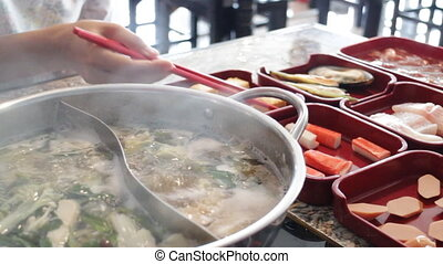 Filling variety meat to hot pot shabu, stock video