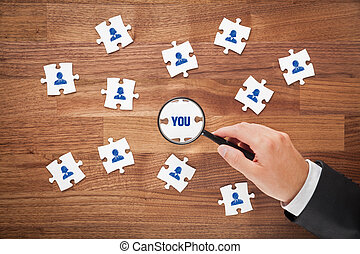 Human resources concept - peace of puzzle. Recruiter or...