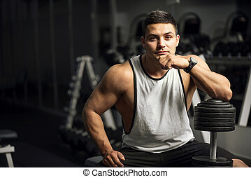 Handsome well built weightlifter sitting thoughtfully - Good...