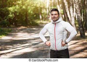 Joyful delighted man enjoying early morning run - Jogging in...
