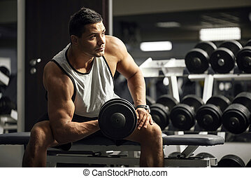Handsome well built man training - Physical strength. Young...