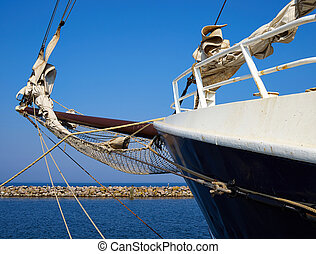 Bowsprit and gathered sail of a large sailing ship -...