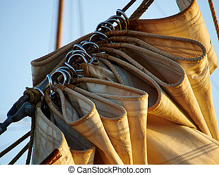 Details of gathered sail of a large sailing ship - Details...