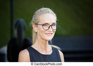 Mature busineswoman - Close up portrait of happy mature...