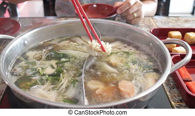 Delicious hot pot shabu meal with seafood, stock video