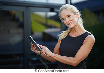 Businesswoman surfing net on tablet - Close up portrait of...