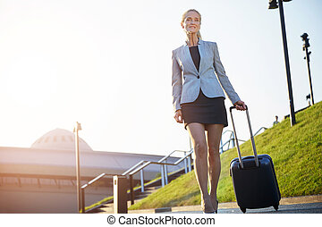 Business trip - Bottom view on mature glad businesswoman...