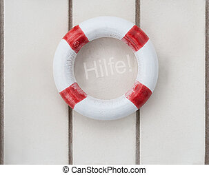 Life buoy - Wooden life buoy on wood with the word Hilfe...