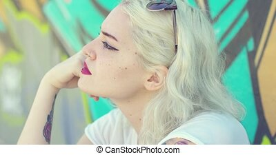 Trendy young woman with a pierced lip - Trendy attractive...