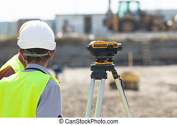 Construction site - Land surveying Construction site worker...