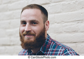 portrait of a smiling man with beard
