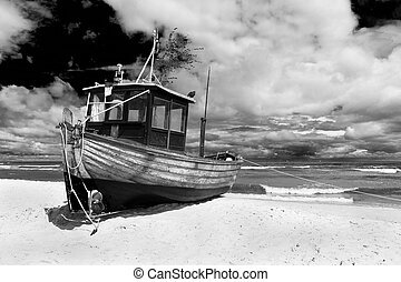 A fishing boat on shore of the Baltic Sea in Ahlbeck,...
