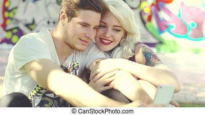 Loving trendy young couple taking a selfie