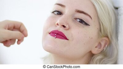 Beautiful young woman with a pierced lip - Beautiful young...