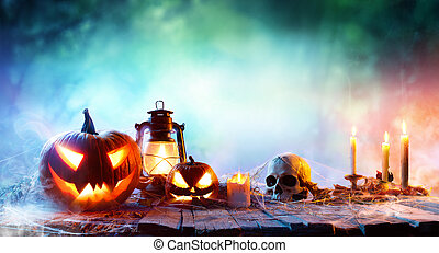 Halloween - Lanterns And Pumpkins On Wooden Table In A...
