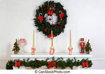 closeup fireplace mantel with wreath and candles