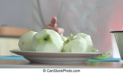 A woman peeled an apple on a plate Part 3 Woman clears the...